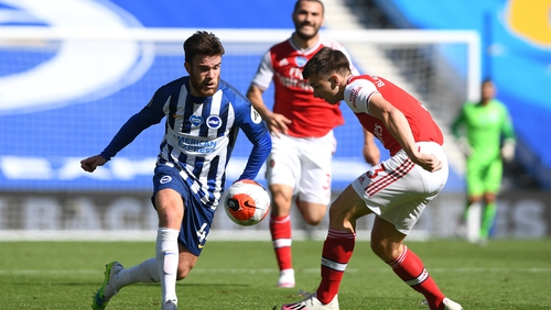 Aaron Connolly challenged by Arsenal's Kieran Tierney