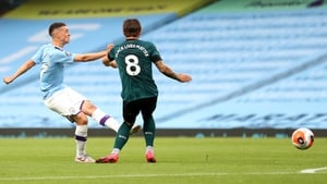 Phil Foden of Manchester City scores his teams first goal