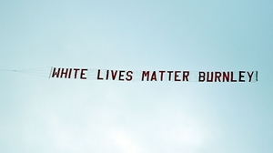 The banner reading 'White Lives Matter Burnley' was towed by a plane above the stadium