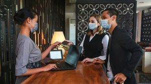 Face masks, online check-in, and more disinfectant than you could fit in the hotel pool.