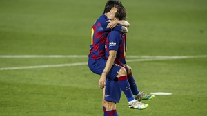 Stop Messi-ing? Ivan Rakitic doesn't seem to be feeling the love as Leo Messi embraces the Barcelona goalscorer