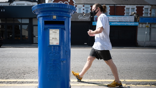 A Royal Mail post box painted blue in recognition of the NHS and other key workers during th Covid-19 pandemic