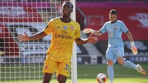 Eddie Nketiah celebrates scoring Arsenal's opener after an error by Alex McCarthy