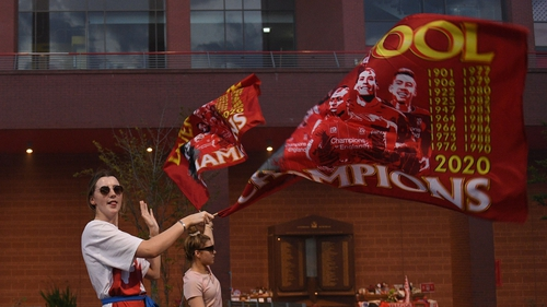 Fans celebrate Liverpool winning the title outside Anfield