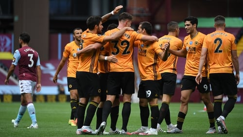 Leander Dendoncker is congratulated by his Wolves team-mates after scoring at Villa Park