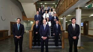 "The new cabinet pose for a socially distant snap: ""government at any time is at the mercy of events"""