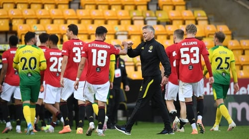 Manchester United manager Ole Gunnar Solskjaer congratulates Bruno Fernandes (18) after the win over Norwich