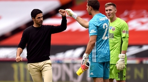 Arsenal manager Mikel Arteta and goalkeeper Emiliano Martinez bump fists after their FA Cup win
