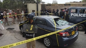 Gunmen attacked the Pakistan stock exchange in Karachi with grenades and guns