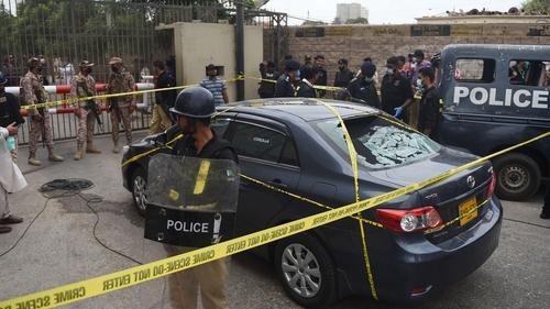 Gunmen attacked the Pakistan stock exchange in Karachi with grenades and guns