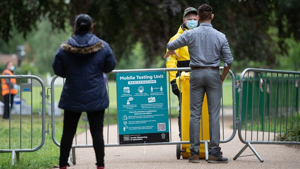 People queue at a walk-in mobile Covid-19 testing centre at Spinney Hill Park in Leicester