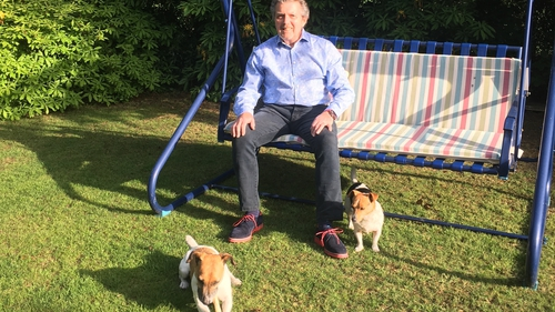 George Hamilton, RTÉ Sport and lyric FM, relaxing in the garden with his two Jack Russells, Brenda and Eddie.