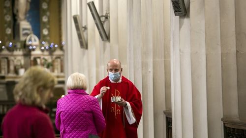 Father Ciaran McDermott celebrates mass at the Pro Cathedral in Dublin