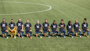 North Carolina Courage players take a knee