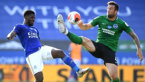 Shane Duffy (R) battles with Kelechi Iheanacho of Leicester City