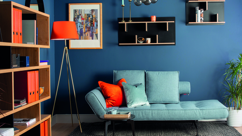 A strong colour choice, mixed with playful orange accents and a unique furnishings create this modern home office designed by Helena Cousins of Zinc Interiors.