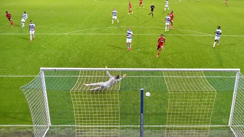 Cyrus Christie (far left) looks on as his thunderbolt finds the back of the net
