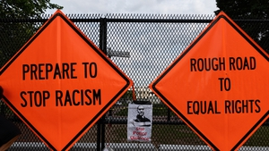 Signs on a fence at Lafayette Park near the White House