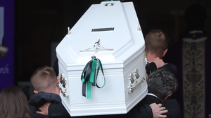 Noah Donohoe's coffin is carried into St Patrick's Church in Belfast
