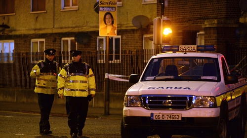 Gardai stand by a van close to the scene of a fatal shooting at a residential address in Dublin on February 9, 2016. Photo credit: Getty Images