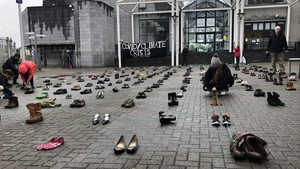 The group asked for shoes to be donated to them and they will be donated to charity on completion of the protest today