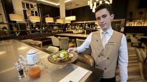 James Allen serves breakfast at the reopened Grand Central Hotel in Belfast