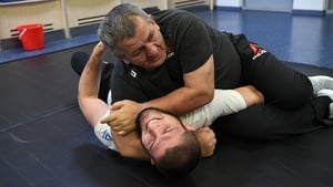 UFC lightweight champion Khabib Nurmagomedov grapples with his father Abdulmanap Nurmagomedov backstage during the UFC Fight Night event in Moscow last November