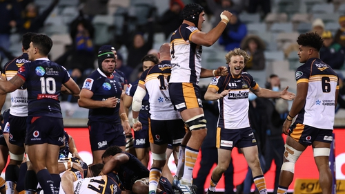 Darcy Swain of the Brumbies celebrates after Will Miller's try
