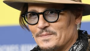 Johnny Depp is suing the publishers of The Sun newspaper (file pic)
