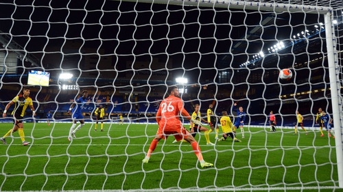 Ross Barkley watches on as his shot flies past Ben Foster to make it 3-0 on the night