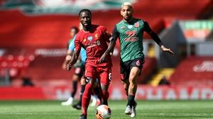 Naby Keita battles for possession with Douglas Luiz