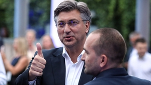 Croatian Prime Minister Andrej Plenkovic reacting to the exit poll showing his HDZ party has outperformed its rivals