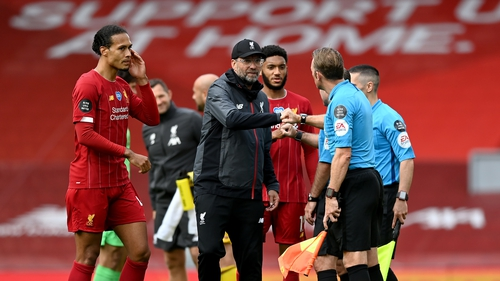 Jurgen Klopp bumps fists with officials after the game