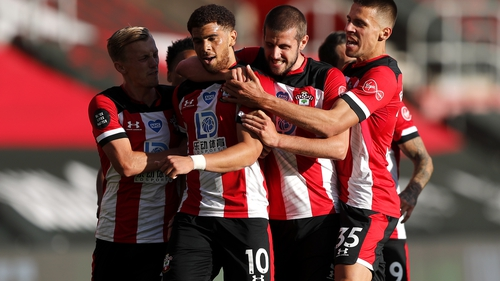 Southampton's Che Adams is mobbed by Southampton team-mates after his goal at St Mary's