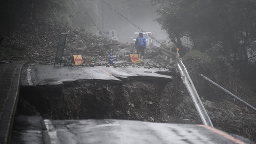 A collapsed road caused by heavy rain in Kuma, Kumamoto prefecture