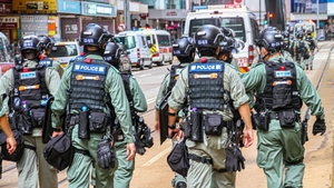 Police on duty during protests in Hong Kong earlier this year