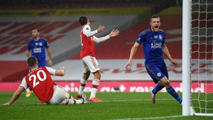 Jamie Vardy steers home Leicester City's 84th-minute equaliser at the Emirates