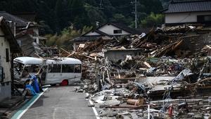 Debris litters a village following heavy rain in Kumamura, Kumamoto, Japan