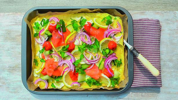 Pancake tray-bake with a salmon, lemon cucumber topping