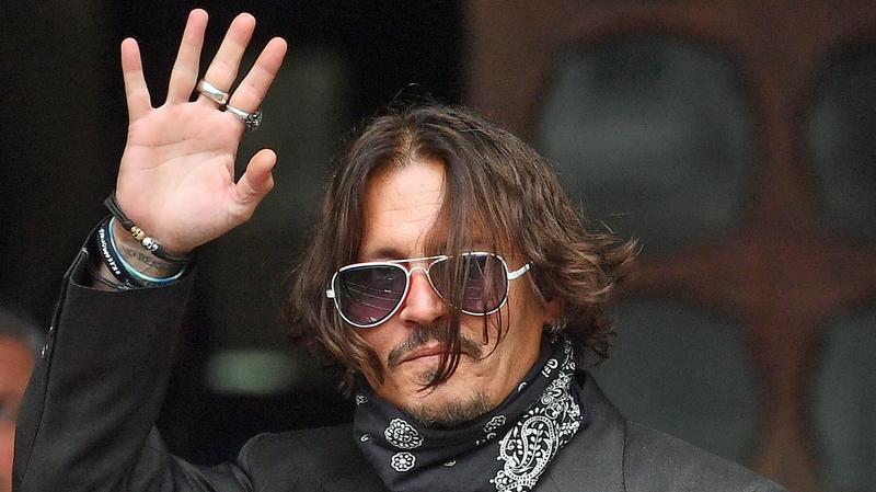 Johnny Depp denies slapping ex-wife Amber Heard