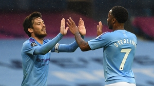 Raheem Sterling (R) high fives midfielder David Silva (L) after scoring City's fifth goal