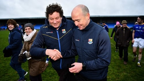 Longford chairman Albert Cooney congratulates manager Padraic Davis after the O'Byrne Cup semi-final win over Dublin in January