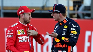 Vettel (l) and Verstappen in discussion during the 2019 season