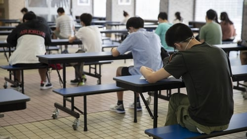 Hong Kong suspends all schools due to virus spike
