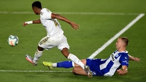 Rodrygo (L) of Real Madrid is tackled by Rodrigo Ely of Alaves