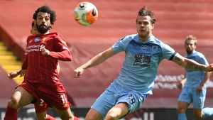 Mohamed Salah of Liverpool is challenged by Kevin Long