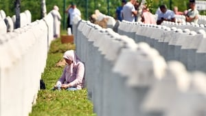 A Bosnian Muslim woman, survivor of the 1995 Srebrenica massacre, at a memorial just outside Srebrenica today, 25 years after the killings
