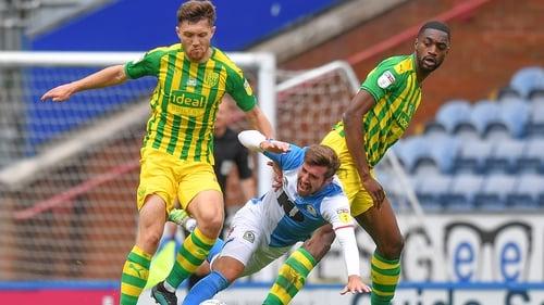 Blackburn Rovers' Joe Rothwell (centre) under pressure at Ewood Park