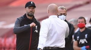 Liverpool manager Jurgen Klopp (L) greets Burnley boss Sean Dyche after the game