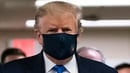 US President Donald Trump wears a mask as he visits Walter Reed National Military Medical Centre in Bethesda, Maryland
